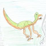 Klaudia narysowała pięknego dinozaura i wygrała nagrodę główną, czyli swój portret