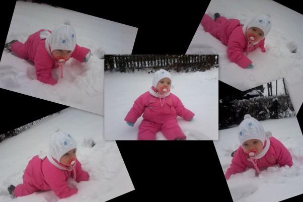 Lenka To są pierwsze zabawy Lenki na śniegu musiała dotknąć a nawet spróbować jak to smakuje.